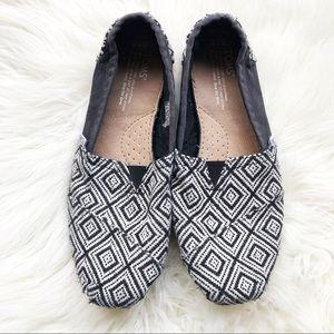 Black and white slip on  TOMS. Size 8.5